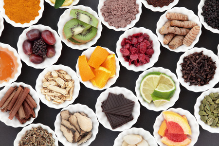 Health food for cold cure and flu remedy with foods high in antioxidants and vitamin c and medicinal herbs. Stock Photo