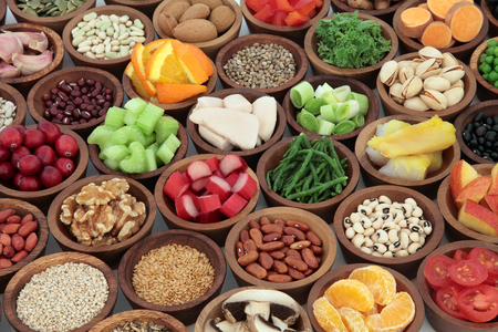 super food: Healthy super food collection in wooden bowls. High in antioxidants, vitamins, minerals and anthocyanins. Stock Photo