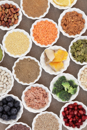 pulses: Health and super food with fish and meat, supplement powders, pulses, nuts, seeds, cereals, grains, fruit and vegetable selection.