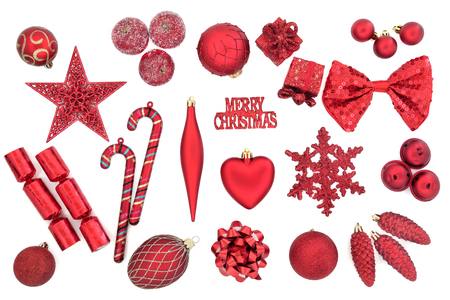 christmas cracker: Red christmas tree bauble decorations over white background.