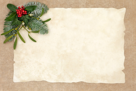 paper old: Old fashioned christmas abstract background  border with flora of holly, ivy, mistletoe and snow covered fir on parchment over hemp paper with copy space.