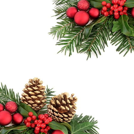 christmas ivy: Christmas border with flora and red baubles, holly, ivy, gold pine cones and winter greenery over white background. Stock Photo