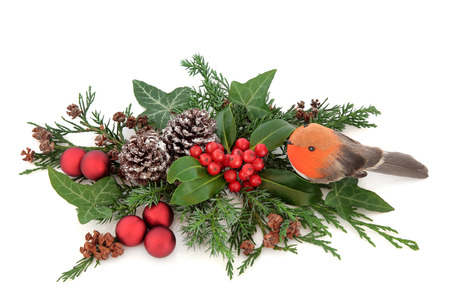christmas robin: Christmas floral decoration with robin and red bauble decorations, holly, ivy, pine cones, cedar cypress and fir over white background.