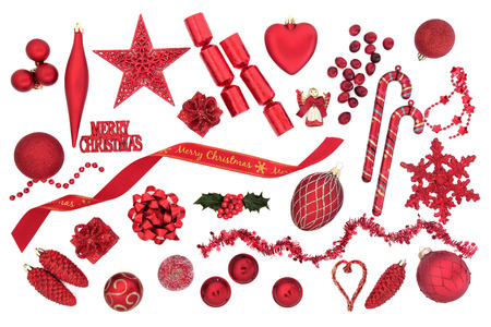 christmas decorations with white background: Christmas decorations in red over white background. Stock Photo