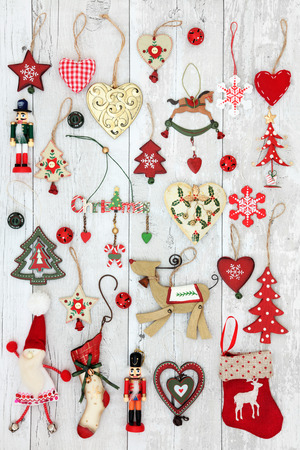old fashioned christmas: Old fashioned christmas tree decorations and baubles over distressed white wood background.