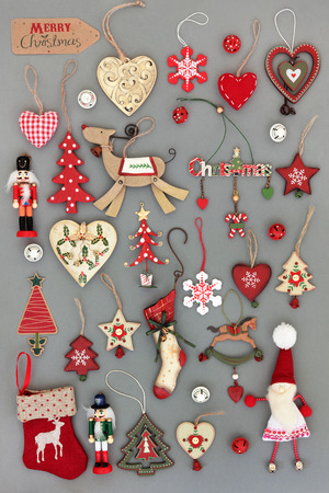 Old fashioned christmas tree baubles and decorations over grey background. Stock Photo