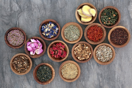 herb medicine: Herb tea collection in wooden bowls also used in natural alternative medicine. Stock Photo