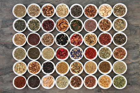 Large herb tea sampler in white china bowls. Teas also used in natural alternative medicine. Stock Photo