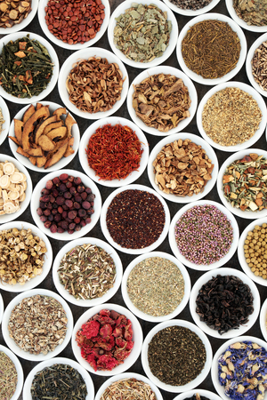 rooibos: Herbal tea selection for good health in white porcelain bowls forming a background. Used also in natural alternative medicine.