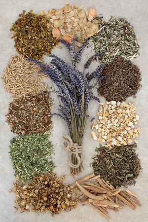 tied in: Herbs to help sleeping and anxiety disorders with lavender herb tied in a bunch on natural hemp paper background.