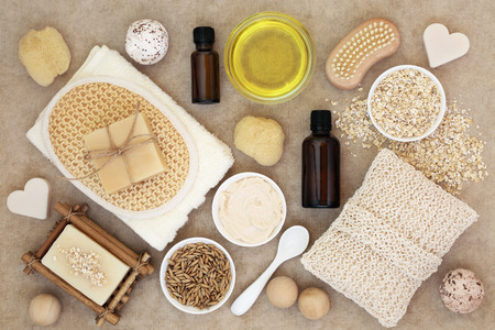 Body and skin care products on natural hemp paper background. Stock Photo