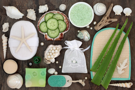 Skincare beauty and exfoliating spa beauty treatment with aloe vera and cucumber and bathroom accessories with pearls and shells. Stock Photo