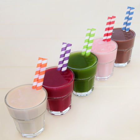 Health food drinks of maca root, pomegranate fruit, wheat grass, acai berryand chocolate whey. Also used by body builders. Stock Photo