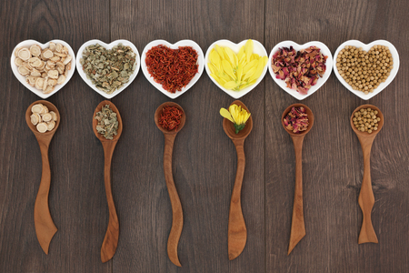 Traditional chinese herb tea selection in heart shaped bowls and wooden spoons. Teas also used in natural alternative medicine.