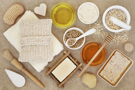 bath supplement: Ingredients for skin and body care beauty treatment on natural hemp paper background.