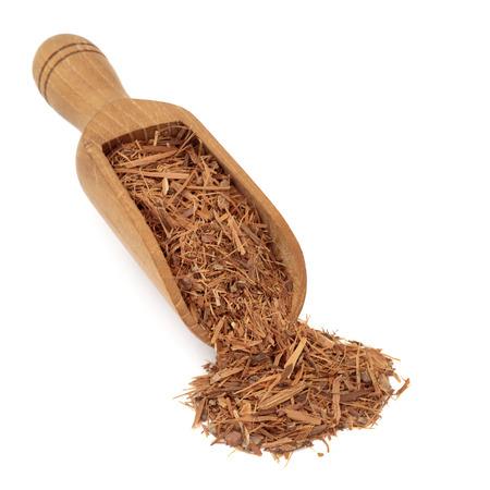 stimulant: Catuaba bark brazillian herbal medicine in a wooden scoop over white background. Used in alternative  medicine as an aphrodisiac.