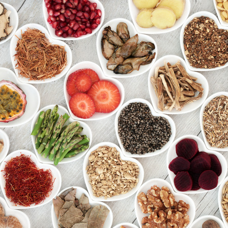 Aphrodisiac food selection for good sexual health on distressed white wood background.