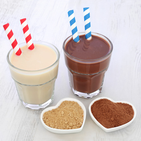 Maca root herb and chocolate whey protein health food supplement drinks in glasses with powders. Also used by body builders.