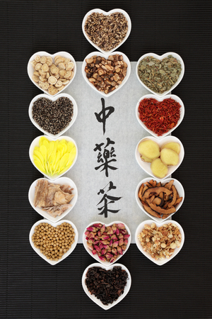 herb medicine: Traditional chinese herb tea selection with calligraphy on rice paper on black ridged paper background. Teas also used in natural alternative medicine. Translation reads as chinese herb tea.