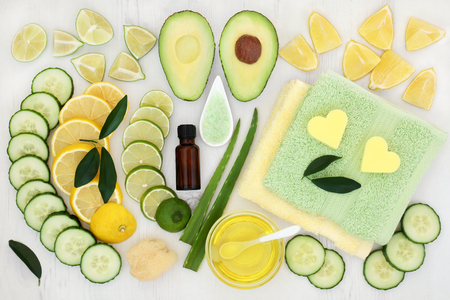 toweling: Body and skin care aromatherapy beauty treatment with cucumber, avocado, aloe vera and citrus fruit with essential oil, ex foliating salt and flannels on distressed white wood background.