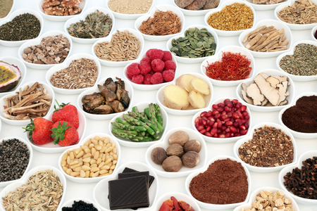 Aphrodisiac food for good sexual health with foods in heart shaped dishes over white background.