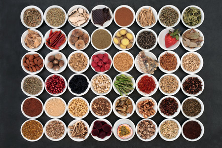 Aphrodisiac food sampler of foods to promote sexual health in china bowls on slate background. Banco de Imagens