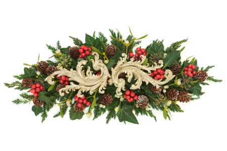 Christmas gold decoration with holly, ivy, mistletoe, fir and pine cones on white background.