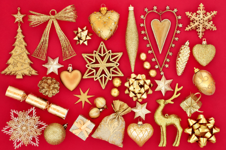 Christmas bauble decorations and symbols in gold on red background. Stock Photo - 83794270
