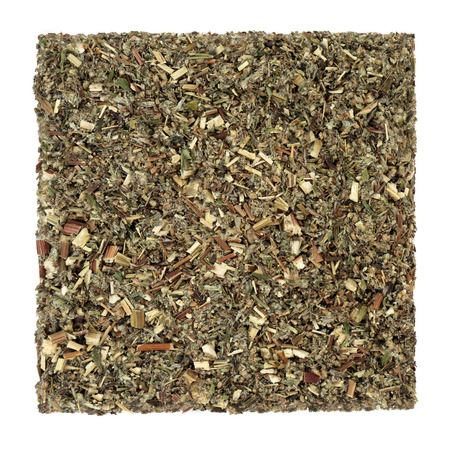 Mugwort leaf herb used in alternative and chinese herbal medicine to stimulate gastric juices and bile secretion, as a liver tonic and sedative, in a mortar with pestle. Artemesia vulgaris. Stockfoto