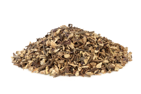 Echinacea root herb used in alternative herbal medicine to boost the immune system, helps to protect against colds and reduces symptoms and has other additional uses to improve health conditions. On white background. Asteraceae, purpurea. Stock Photo