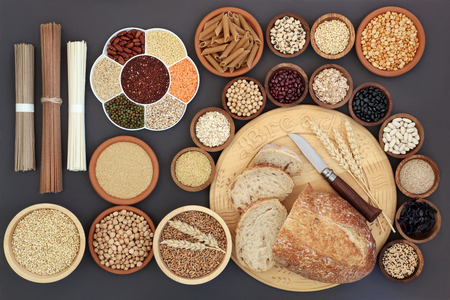 Dried macrobiotic diet health food concept with sourdough bread, soba and udon noodles, legumes, seaweed, grain, cereal, seeds and whole wheat pasta. Foods high in smart carbohydrates, protein, antioxidants and fiber. Top view. Stock Photo