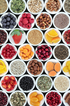Super food for a healthy heart including fruit, vegetables, grain, omega 3, nuts, seeds and herbal medicine. High in antioxidants, anthocyanins, vitamins, and minerals. Stock Photo