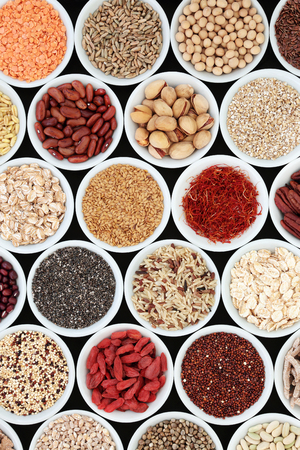 Dried high fiber health food with legumes, cereals, nuts, grain, fruit, seeds, with foods high in omega 3 fatty acid, antioxidants and vitamins, top view. Stock fotó