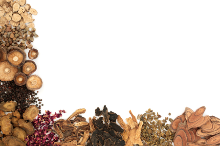 Chinese herbs used in traditional herbal medicine forming a background border on white background.