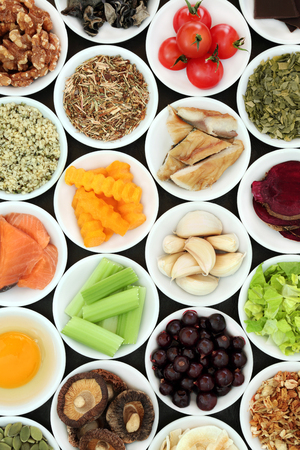 Food to boost brain power concept with foods high in antioxidants, anthocyanins, omega 3 fatty acids, minerals and vitamins.