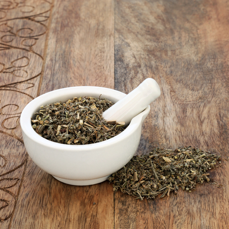 Wormwood leaf herb used in alternative herbal medicine to treat anorexia, indigestion and anaemia it also has many other health benefits. An ingredient in the spirit absinthe. Artemesia absinthium. Stock Photo