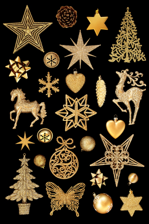 Gold Christmas tree bauble decorations on isolated on black background.