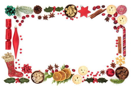 Christmas festive background border with decorations, food, winter flora, seasonal symbols and gold, frankincense and myrrh. Gift tag or card for the holiday season.