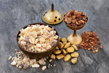 Gold frankincense and myrrh religious concept of gifts of the three wise men at Christmas celebrating the birth of Christ. Stock Photo