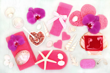Spa beauty skincare and body care treatment products including himalayan exfoliating salt and scrub, natural soaps, sponges and flannel. Health care concept, top view. Stock Photo