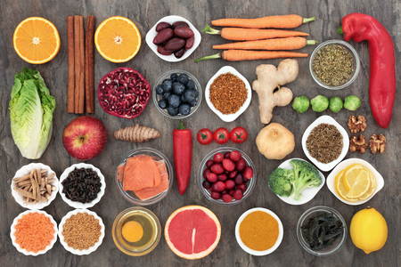 Healthy food to slow the ageing process concept including fruit, vegetables, fish, seeds, nuts, herbs, spices and pollen grain. Very high in antioxidants, anthocyanins, dietary fibre and vitamins. Stok Fotoğraf