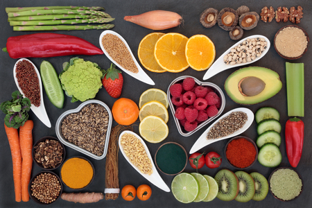 Health food selection for liver detox concept with fresh fruit, vegetables, legumes, herbal medicine, grains, seeds, supplement powders, herbs and spices. Top view on slate. Stock Photo