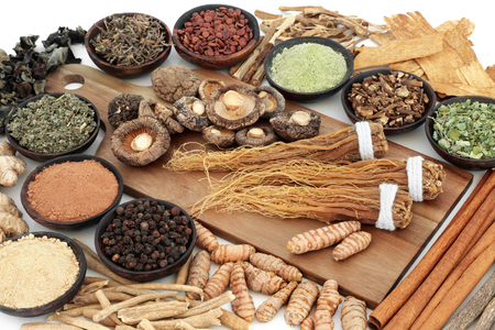 Adaptogen food assortment with herbs, spices and supplement powders. Used in herbal medicine to help the body resist the damaging effect of stress and restore normal physiological functioning.