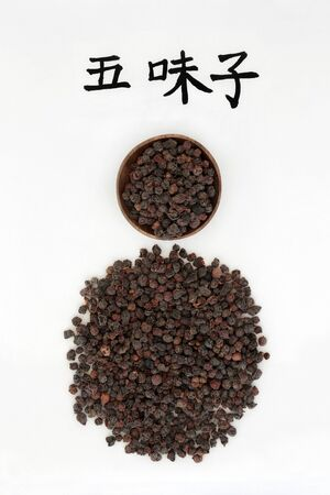 Chinese schisandra berries, magnolia vine, used in chinese herbal medicine with calligraphy script, used as an astringent and sedative and has many other health benefits. Translation reads as magnolia vine schisandra. Wu wei zi.