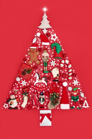 Christmas tree abstract decoration with baubles, ornaments and snow flakes on red background. Traditional theme with symbols for the festive season.