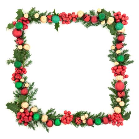 Christmas background square border with red, green and gold bauble decorations, with winter holly and juniper fir leaves on white background with copy space. Festive decoration.
