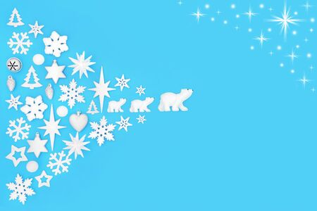 Christmas background with bauble decorations and stars on blue with copy space. Traditional symbols for the festive season and North Pole and Three Wise Polar Bear themes.