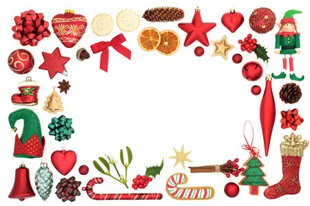 Decorative Christmas background border with festive bauble decorations and symbols on white background with copy space.