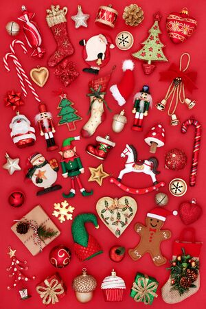 Christmas tree bauble decorations and ornaments on red background. Traditional theme with symbols for the festive season.