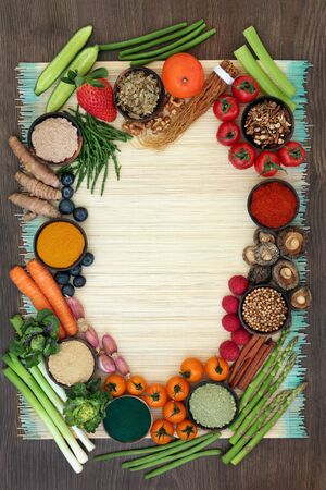 Liver detox diet health food concept with fresh fruit, vegetables, herbs, spices, dietary supplements and herbal medicine. Foods high in antioxidants, anthocyanins, vitamins &  dietary fibre. Top view.